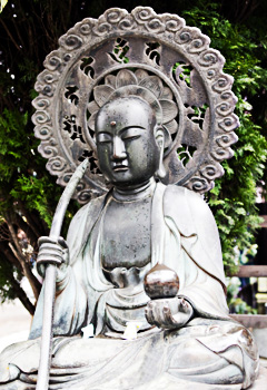 Bronze buddha with parasol in Japan
